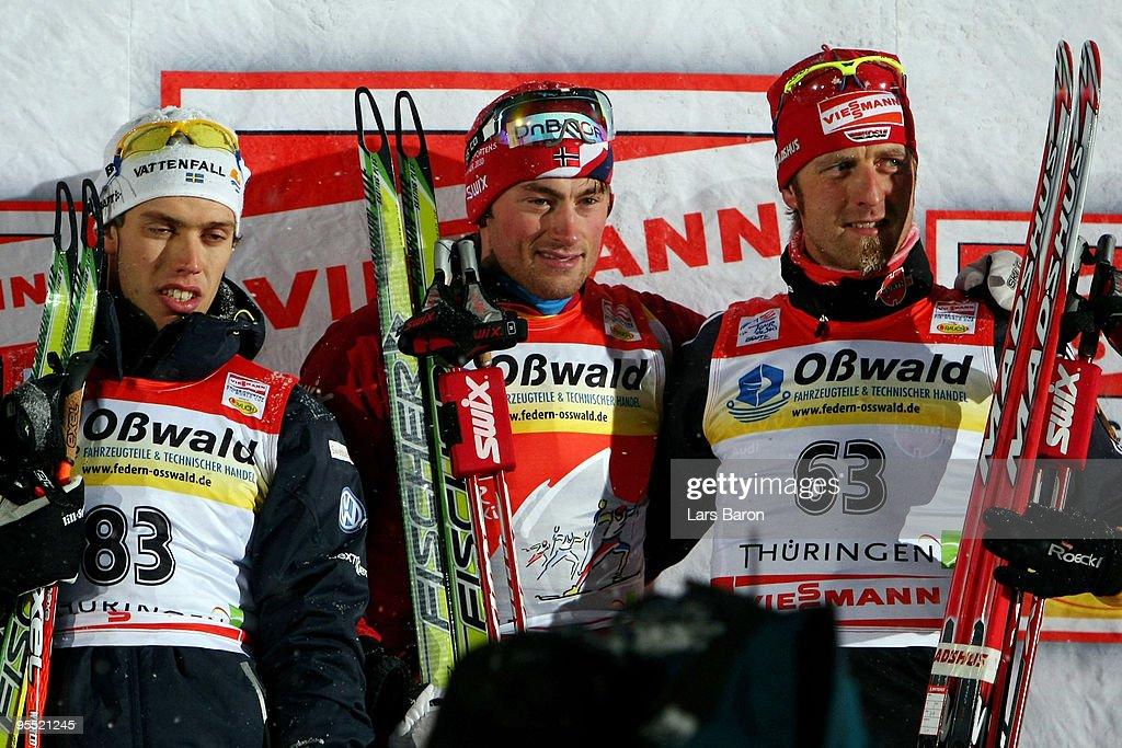 First placed <a gi-track='captionPersonalityLinkClicked' href=/galleries/search?phrase=Petter+Northug&family=editorial&specificpeople=800847 ng-click='$event.stopPropagation()'>Petter Northug</a> of Norway (C), 2nd placed Marcus Hellner of Sweden (L) and 3rd placed <a gi-track='captionPersonalityLinkClicked' href=/galleries/search?phrase=Axel+Teichmann&family=editorial&specificpeople=773876 ng-click='$event.stopPropagation()'>Axel Teichmann</a> of Germany (R) pose after the Men's 3,7km Prologue of the FIS Tour De Ski at the DKB Arena on January 1, 2010 in Oberhof, Germany.