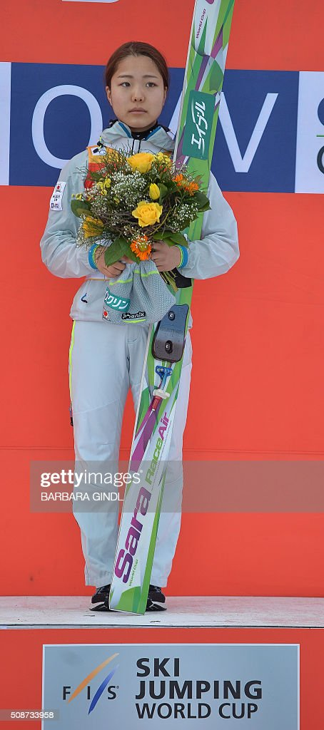 First placed Sara Takanashi of Japan poses on the podium after the women's ski jumping world cup in Hinzenbach, Upper Austria on February 6, 2016. / AFP / APA / BARBARA GINDL / Austria OUT