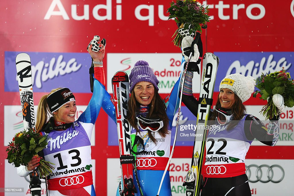 First placed <a gi-track='captionPersonalityLinkClicked' href=/galleries/search?phrase=Tina+Maze&family=editorial&specificpeople=213514 ng-click='$event.stopPropagation()'>Tina Maze</a> (C) of Slovenia celebrates at the flower ceremony with second placed <a gi-track='captionPersonalityLinkClicked' href=/galleries/search?phrase=Lara+Gut&family=editorial&specificpeople=4860592 ng-click='$event.stopPropagation()'>Lara Gut</a> (L) of Switzerland and third placed <a gi-track='captionPersonalityLinkClicked' href=/galleries/search?phrase=Julia+Mancuso&family=editorial&specificpeople=214615 ng-click='$event.stopPropagation()'>Julia Mancuso</a> (R) of the United States of America following the Women's Super G event during the Alpine FIS Ski World Championships on February 5, 2013 in Schladming, Austria.