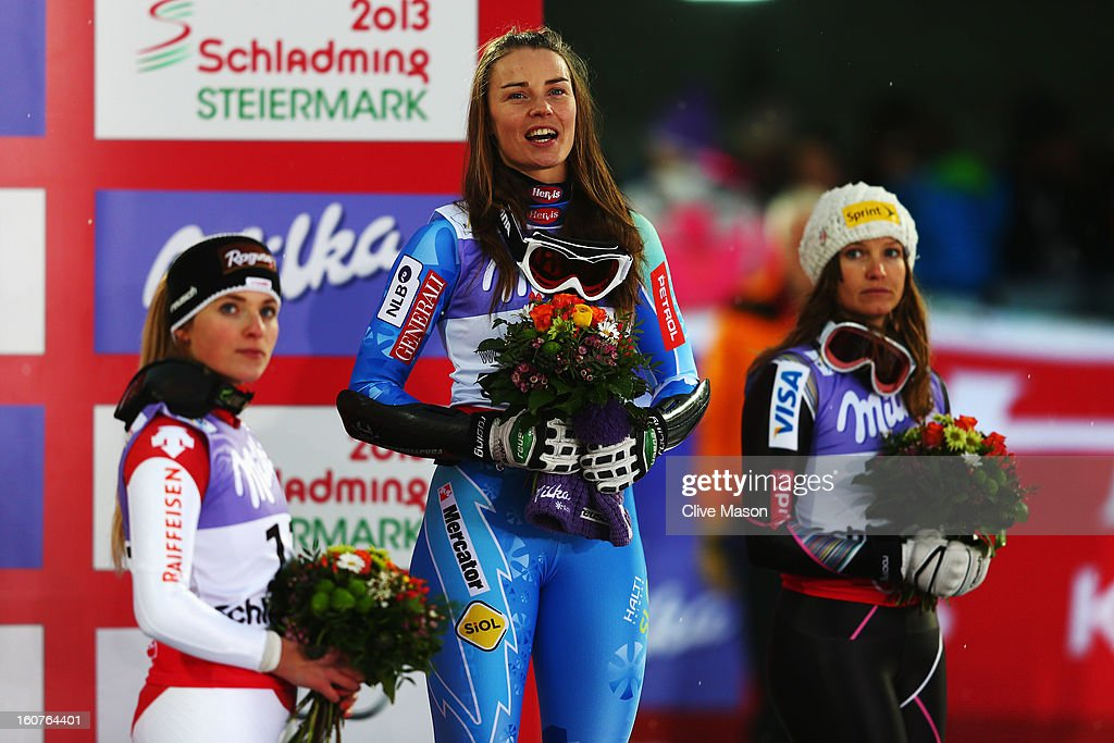 First placed Tina Maze (C) of Slovenia celebrates at the flower ceremony with second placed Lara Gut (L) of Switzerland and third placed Julia Mancuso (R) of the United States of America following the Women's Super G event during the Alpine FIS Ski World Championships on February 5, 2013 in Schladming, Austria.
