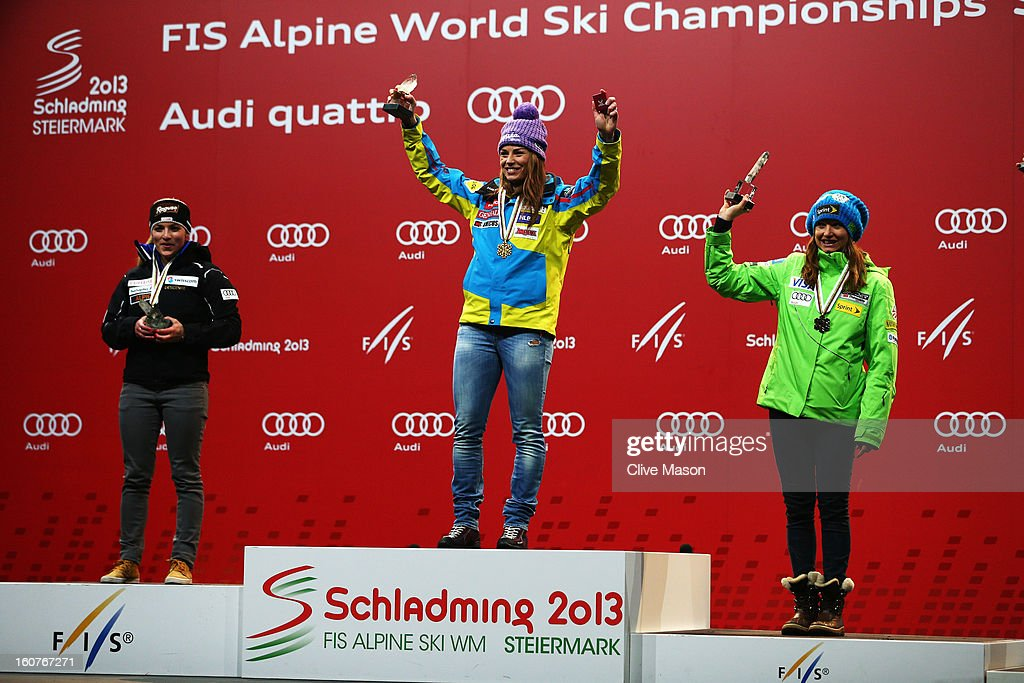 First placed Tina Maze (C) of Slovenia celebrates at the medal ceremony with second placed Lara Gut (L) of Switzerland and third placed Julia Mancuso (R) of the United States of America following the Women's Super G event during the Alpine FIS Ski World Championships on February 5, 2013 in Schladming, Austria.