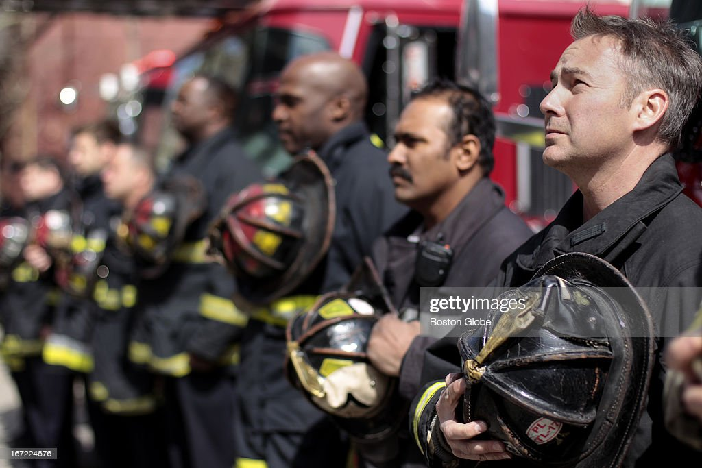 First Responders - Firefighter Mark Sanders and fellow firefighters from Engine 7 Tower Ladder 17 who were first responders at the Marathon bombings, observe a moment of silence at 2:50 p.m., one week after the attack, in front of their firehouse on Columbus Avenue. A moment of silence was held at 2:50 p.m. for the victims of the Boston Marathon bombings which occurred one week ago today.