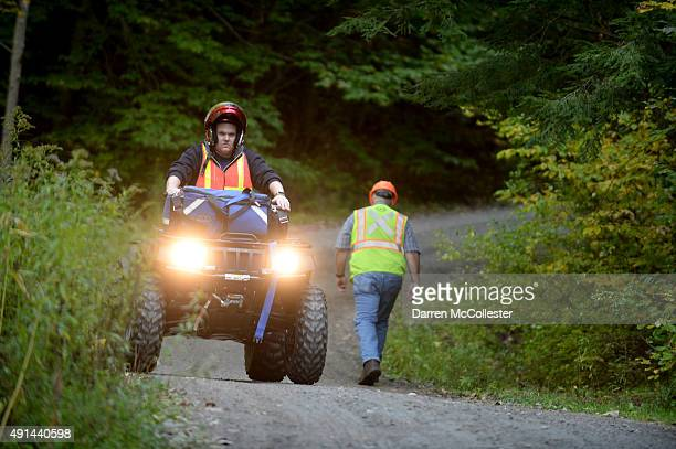 First responders ride ATV's down an access road near the scene of an Amtrak train derailment October 5 2015 in Northfield Vermont According to...
