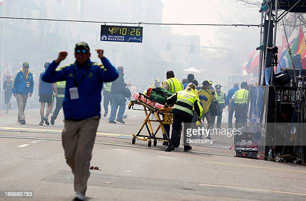 First responders rush to where two explosions occurred along the final stretch of the Boston Marathon on Boylston Street in Boston Massachusetts US...