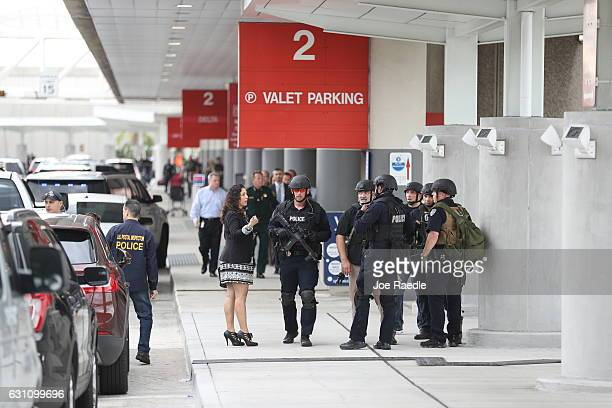 First responders secure the area outside the Fort LauderdaleHollywood International airport after a shooting took place near the baggage claim on...
