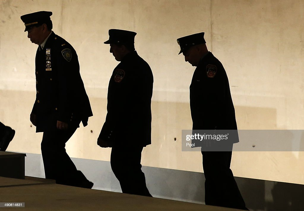 First responders to the September 11 2001 attacks on the World Trade Center walk to the stage during the opening ceremony for the National September 11 Memorial Museum at ground zero May 15, 2014 in New York City. The museum spans seven stories, mostly underground, and contains artifacts from the attack on the World Trade Center Towers on September 11, 2001 that include the 80 ft high tridents, the so-called 'Ground Zero Cross,' the destroyed remains of Company 21's New York Fire Department Engine as well as smaller items such as letter that fell from a hijacked plane and posters of missing loved ones projected onto the wall of the museum. The museum will open to the public on May 21.