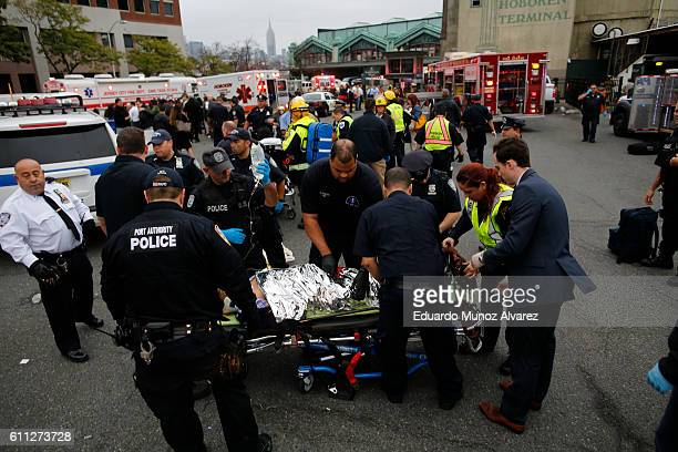 First responders treat injured passengers after a New Jersey Transit train crashed into the platform at Hoboken Terminal during morning rush hour...