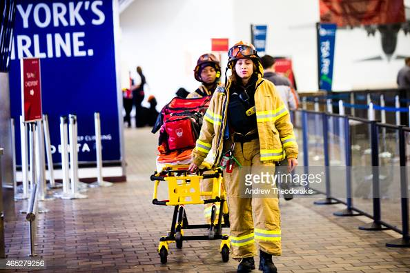 First responders walk through the terminal March 5 2015 at LaGuardia Airport in the Queens borough of New York City A Delta jet partially skidded off...