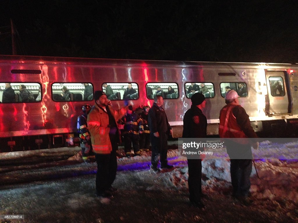 First responders work at the scene of a train accident on February 3 2015 in Valhalla New York A MetroNorth commutor train carrying hundreds of...