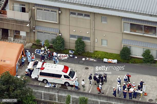 First responders work at the scene outside a residential care facility for the disabled where at least 15 people were killed and more than 25 injured...
