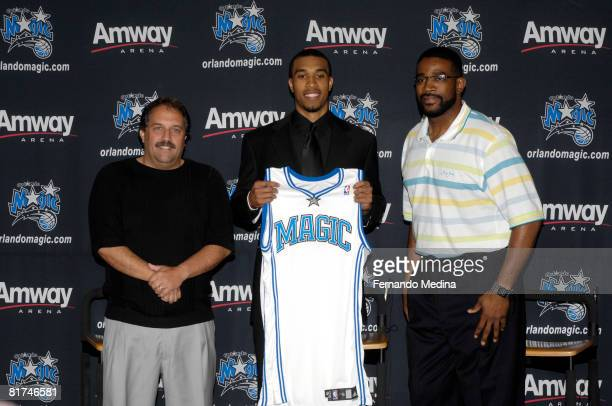 NBA first round draft pick Courtney Lee of the Orlando Magic flanked by head coach Stan Van Gundy and general manager Otis Smith holds up a Magic...