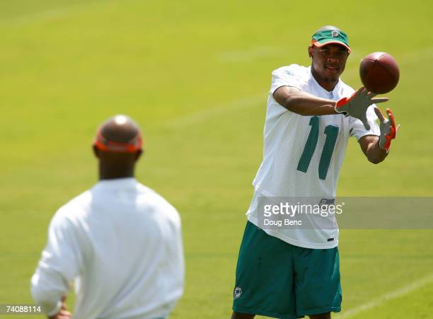 First round draft pick Ted Ginn Jr #11 of the Miami Dolphins works out during Rookie Camp at Nova Southeastern University in Davie Florida