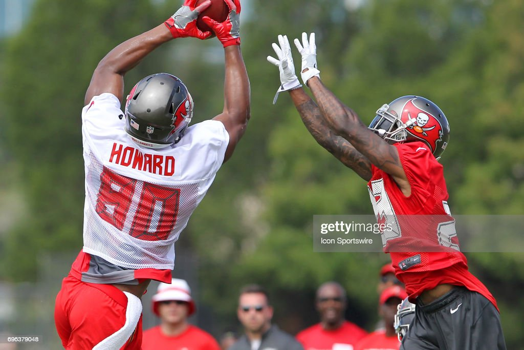 2017 first round pick O. J. Howard makes the touchdown catch as safety Ryan Smith (29) attempts to knock the ball loose during the Tampa Bay Buccaneers Minicamp on June 15, 2017 at One Buccaneer Place in Tampa, Florida.