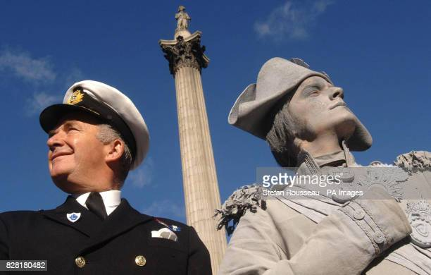 First Sea Lord and Chief of Naval Staff Admiral Sir Alan West is joined by a 'living statue' of Admiral Lord Nelson stand in front of Nelson's Column...