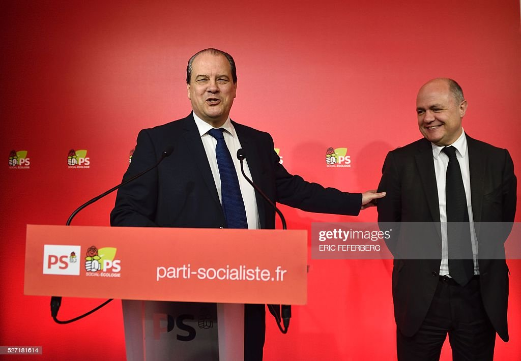First secretary of the French Socialist Party, Jean-Christophe Cambadelis (L) and President of the Socialist parliamentary group at the National Assembly, Bruno Le Roux hold a press conference on May 2, 2016 in Paris, during the launching of the party's campaign 'Du Progres en Plus' (Further Progress) aimed at highlighting the five-year term of the French Socialist president, and gather the Left a year ahead the 2017 presidential elections. / AFP / Eric FEFERBERG