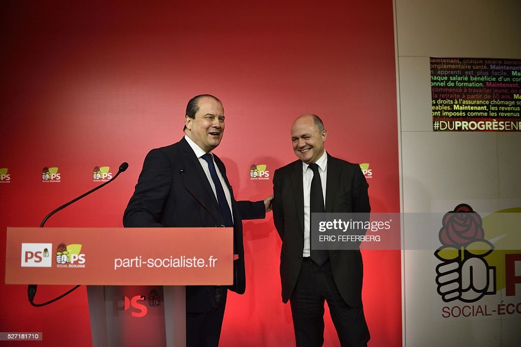First secretary of the French Socialist Party, Jean-Christophe Cambadelis (L) and President of the Socialist parliamentary group at the National Assembly, Bruno Le Roux hold a press conference on May 2, 2016 in Paris, during the launching of the party's campaign 'Du Progres en Plus' (Further Progress) aimed at highlighting the five-year term of the French Socialist president, and gather the Left a year ahead the 2017 presidential elections. / AFP / ERIC