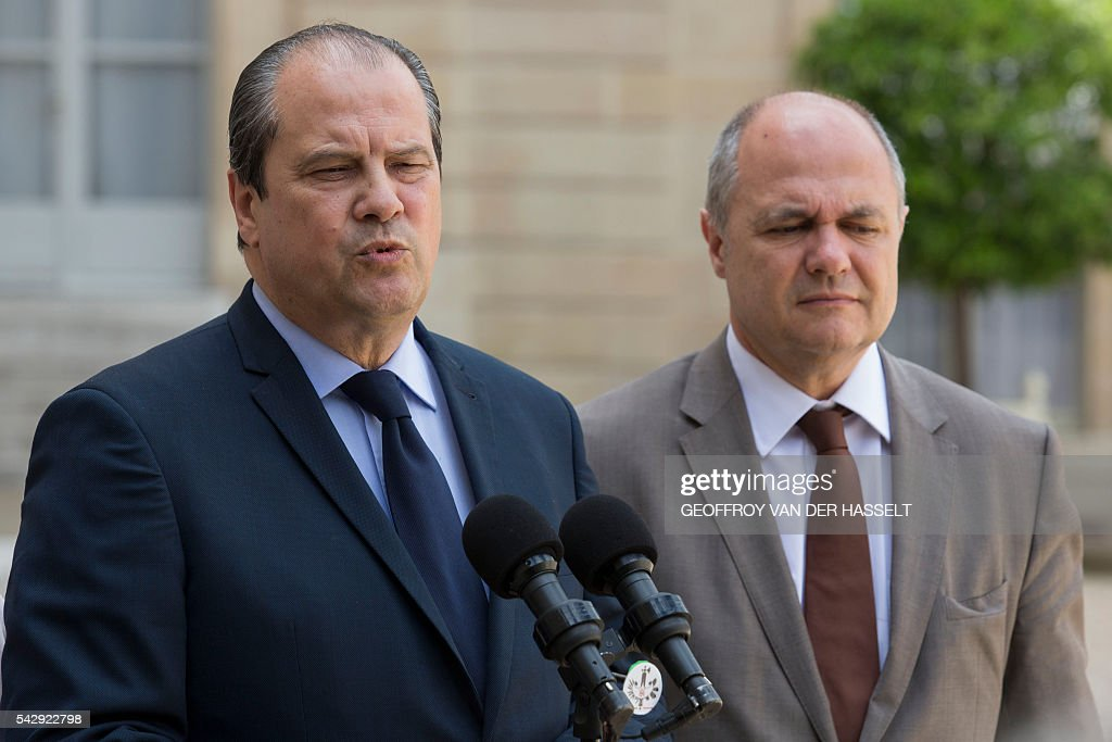First Secretary of the French Socialist Party, Jean-Christophe Cambadelis (L) speaks to the press next to president of the Socialist party parliamentarty group at the French national Assembly Bruno Le Roux (R), following a meeting after Britain voted to leave the European Union the day before, on June 25, 2016 at the Elysee presidential Palace in Paris. As the 'Brexit' vote sent global financial markets into freefall, Moody's cut Britain's credit rating outlook to 'negative', saying the vote to pull out of the European Union could hurt its economic prospects. / AFP / GEOFFROY