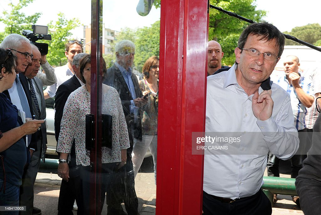 First Secretary of the French Socialist Party Martine Aubry (L), arrives in the Bagatelle neighbourhood in Toulouse, southern France during a campaign visit on May 29, 2012, to support Socialist Christophe Borgel (L) in the Haute-Garonne 9th constituency, candidate for the French parliamentary election, next June.