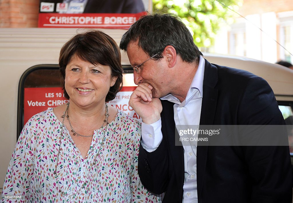 First Secretary of the French Socialist Party Martine Aubry (L) listens to Socialist Christophe Borgel in the Haute-Garonne 9th constituency when campaining on May 29, 2012 in Le Portet-sur-Garonne, near Toulouse, southern France, to support the candidate for the French parliamentary election.