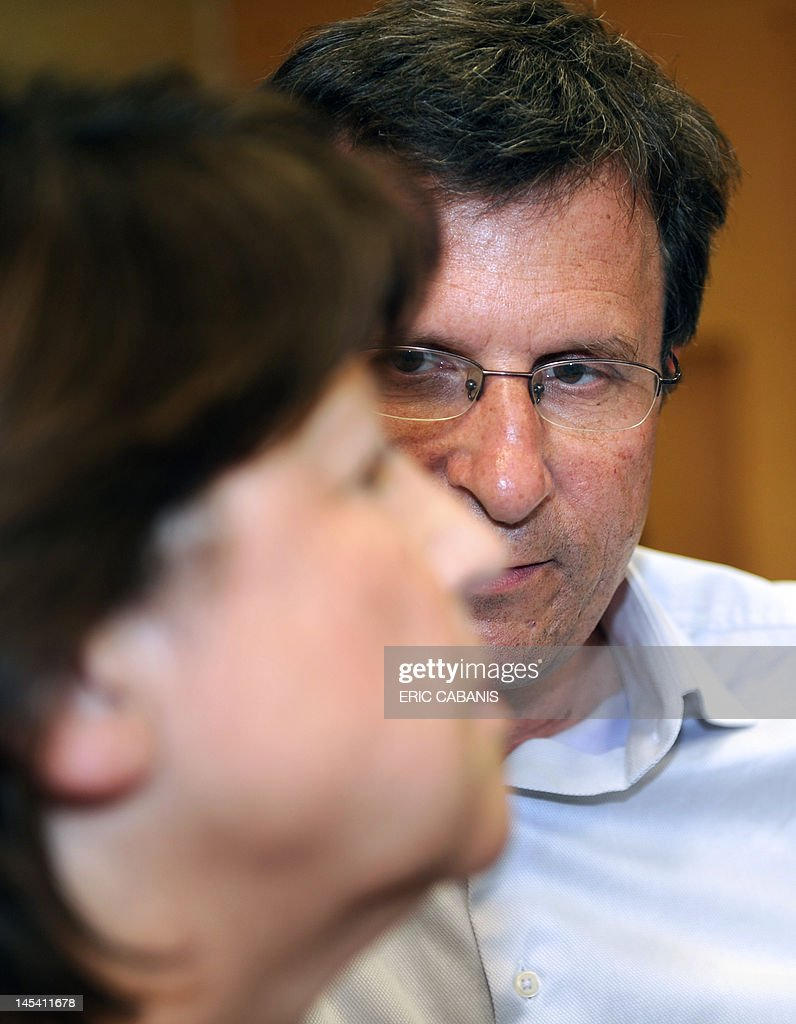 First Secretary of the French Socialist Party, Martine Aubry (L), speaks with Socialist Christophe Borgel (R), candidate in the Haute-Garonne 9th constituency, in the Bagatelle neighbourhood in Toulouse, southern France during a meeting campaining, on May 29, 2012, to support the candidate to the French parliamentary election, next June.