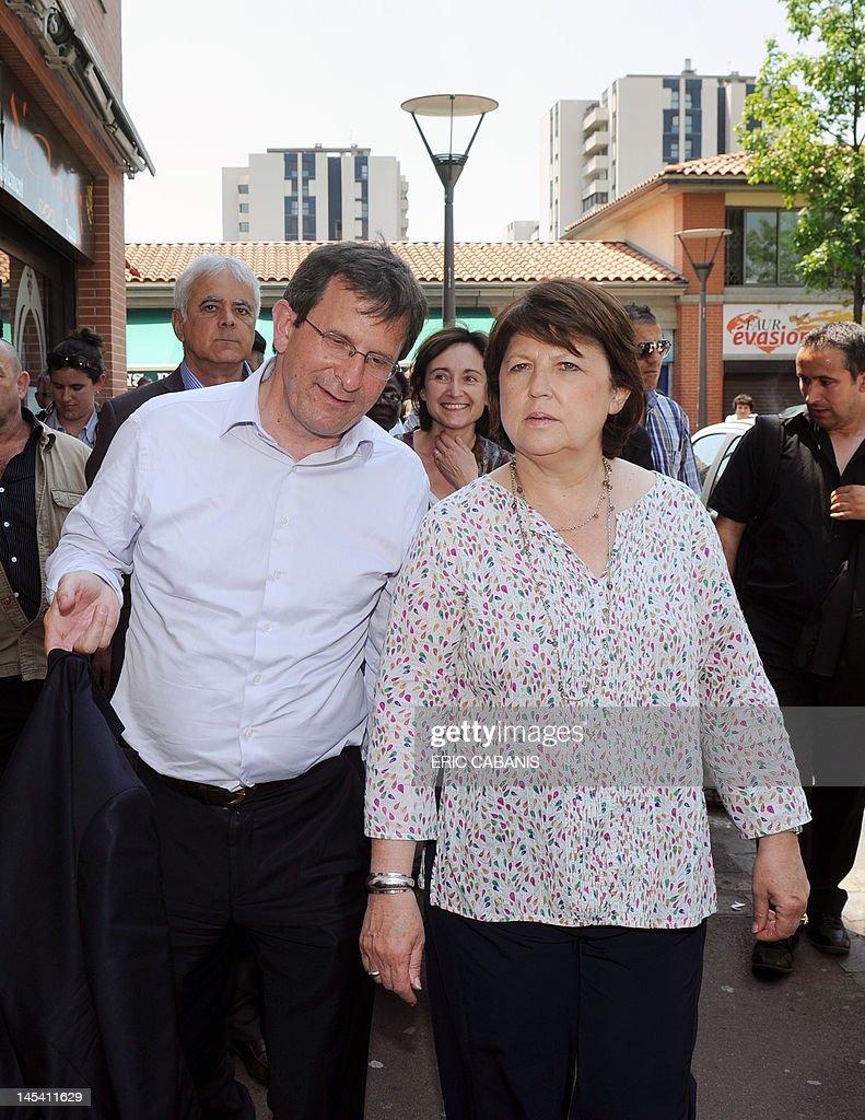 First Secretary of the French Socialist Party Martine Aubry (R), walks in the Bagatelle neighbourhood in Toulouse, southern France when campaining, on May 29, 2012, to support Socialist Christophe Borgel (L) in the Haute-Garonne 9th constituency, candidate for the French parliamentary election, next June.
