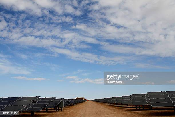 First Solar Inc photovoltaic solar panels reflect light at the Agua Caliente Solar Project in Yuma County Arizona US on Wednesday Feb 16 2012 Arizona...