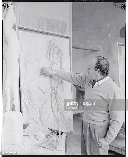 First Stage Milan Italy Sculptor Giacomo Manzu prepares sketches for a plaster panel representing a scene from the resurrection of Christ as he...