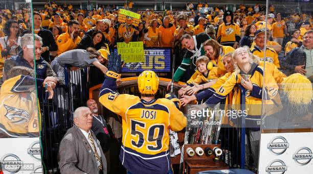 First Star of the Game Roman Josi of the Nashville Predators waves to fans after a 21 win against the Anaheim Ducks in Game Three of the Western...