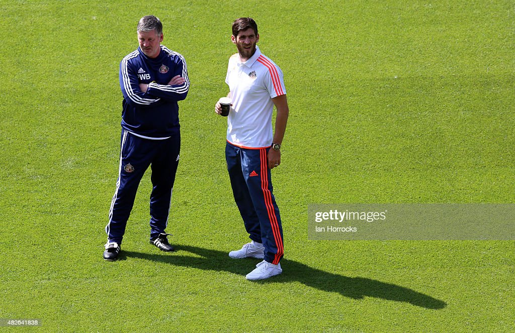 First team coach Paul Bracewell and Danny Graham of Sunderland inspect the Hannover pitch prior to the PreSeason friendly match between Hannover 96...