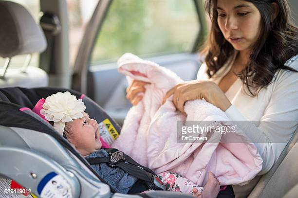 First time mother struggling to put baby in carseat