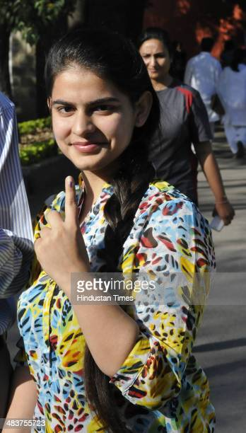 A first time voter showing her inked finger after casting her vote at Government Model Senior Secondary School Sec18 on April 10 2014 in Chandigarh...