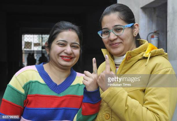 First time voters in jubilant mood showing their inked fingers after casting their votes on February 4 2017 in Ludhiana India Punjab on Saturday...