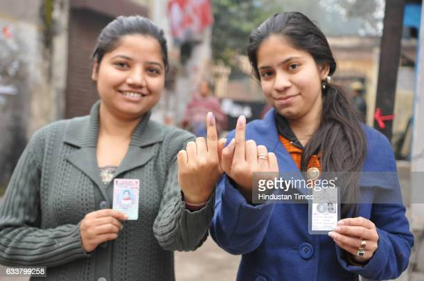 First time voters showing their fingers after casting their votes on February 4 2017 in Jalandhar India Punjab on Saturday voted in its first and...