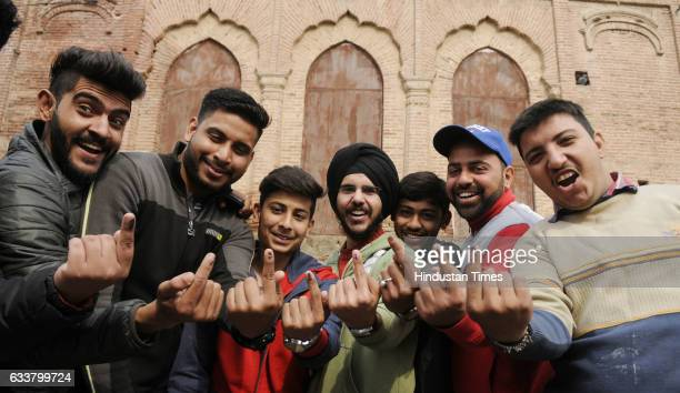 First time voters showing their inked fingers after casting their votes outside Qila Mubarak on February 4 2017 in Patiala India Punjab on Saturday...