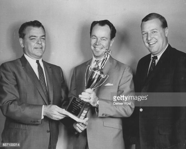 First Trophy for the News Carl Hatcher left Denver Post retail advertising manager presents the Denver PostRocky Mountain Mens Wear Association golf...