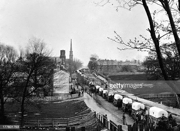 First Union wagon train entering the city of Petersburg with provisions after the Rebels were forced to evacuate Petersburg Virginia 1865 The City...