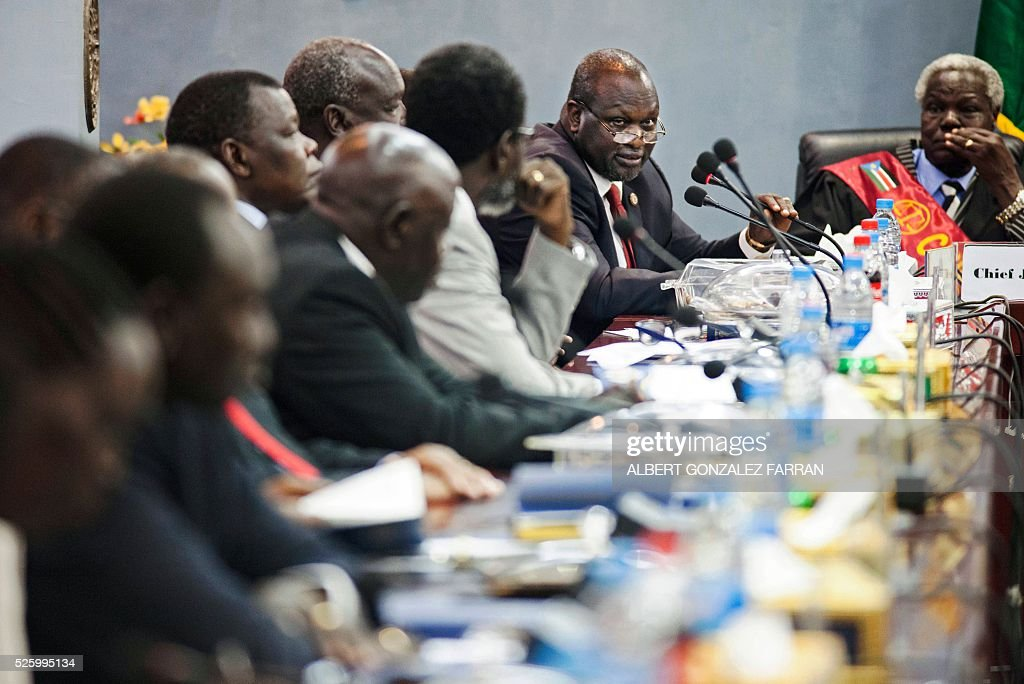 First Vice President of South sudan and former rebel leader Riek Machar (2nd R) addresses the 30 newly elected members of the cabinet of the Transitional Government at the Cabinet Affairs Ministry in Juba on April 29, 2016. South Sudan President Salva Kiir has named his transitional unity government, sharing power with ex-rebels in a key step in a long-delayed peace process, a decree read out on April 29 said. Under terms of an August 2015 peace deal, the 30 ministerial posts are split between Kiir, former rebel chief turned first vice president Riek Machar, opposition and other parties. FARRAN