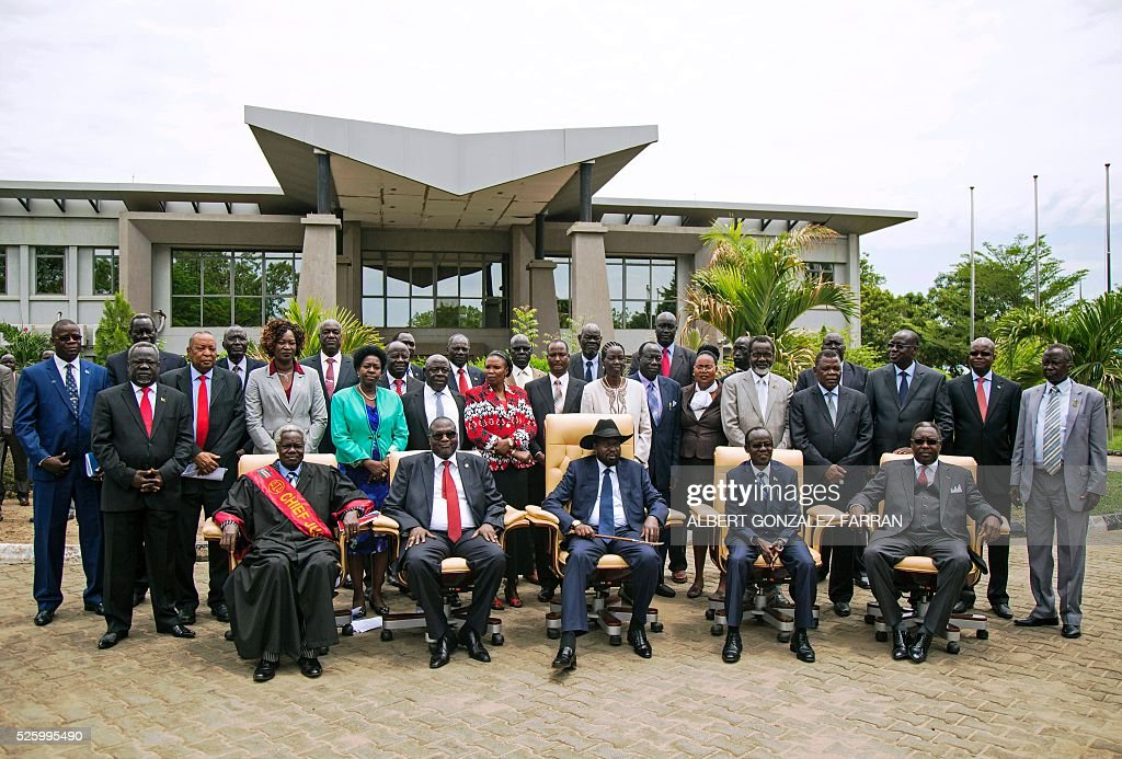 First Vice President of South Sudan and former rebel leader Riek Machar, South Sudan President Salva Kiir and Second Vice President of South Sudan James Wani Igga pose along with the 30 members of the new cabinet of the Transitional Government outside the Cabinet Affairs Ministry in Juba on April 29, 2016. South Sudan President Salva Kiir has named his transitional unity government, sharing power with ex-rebels in a key step in a long-delayed peace process, a decree read out on April 29 said. Under terms of an August 2015 peace deal, the 30 ministerial posts are split between Kiir, former rebel chief turned first vice president Riek Machar, opposition and other parties. FARRAN