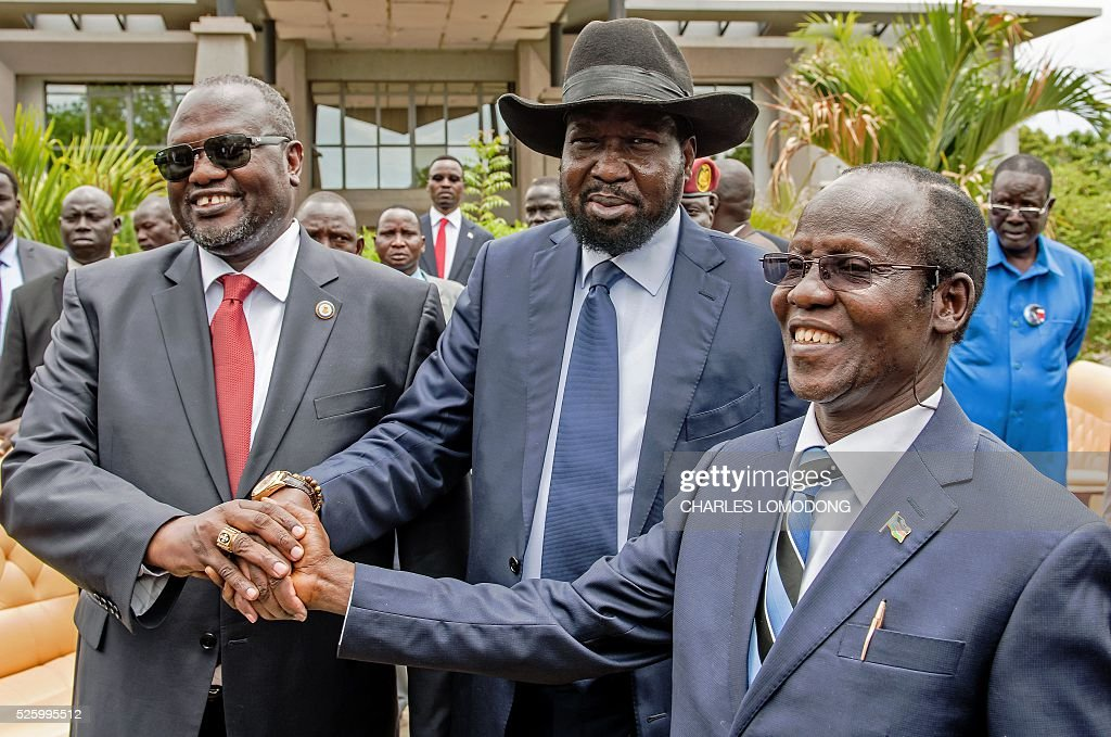 First Vice President of South Sudan and former rebel leader Riek Machar, South Sudan President Salva Kiir and Second Vice President of South Sudan James Wani Igga shake hands after the formation of the new cabinet of the Transitional Government at the Cabinet Affairs Ministry in Juba on April 29, 2016. South Sudan President Salva Kiir has named his transitional unity government, sharing power with ex-rebels in a key step in a long-delayed peace process, a decree read out on April 29 said. Under terms of an August 2015 peace deal, the 30 ministerial posts are split between Kiir, former rebel chief turned first vice president Riek Machar, opposition and other parties. LOMODONG