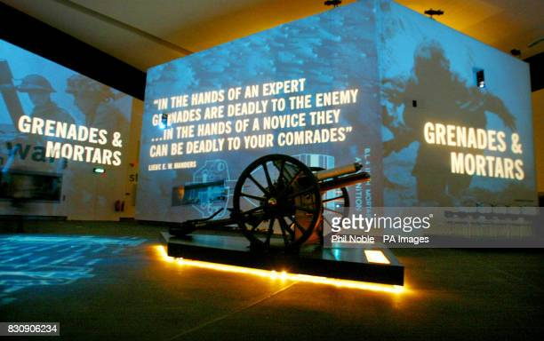 A First World War field gun stands in front of an audiovisual display inside the Imperial War Museum North in Manchester The museum is the first...