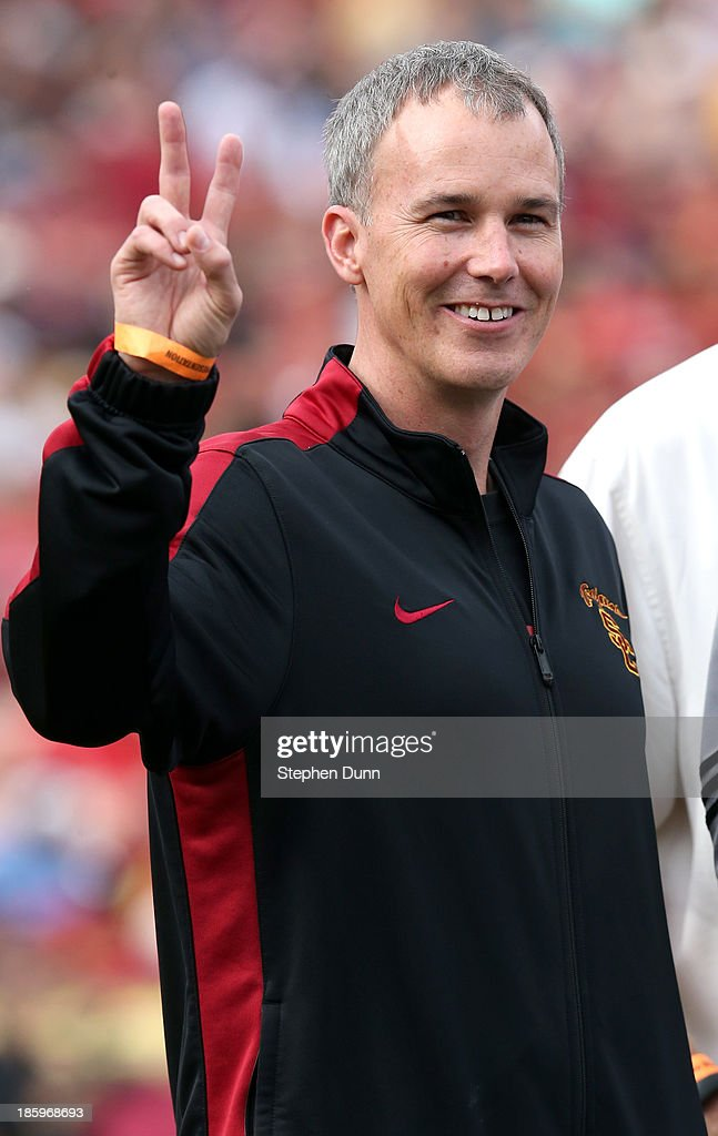 First year head basketball coach <a gi-track='captionPersonalityLinkClicked' href=/galleries/search?phrase=Andy+Enfield&family=editorial&specificpeople=5624033 ng-click='$event.stopPropagation()'>Andy Enfield</a> of the USC Trojans gives a Trojan salute as he appears on the field during the game with the Utah Utes at Los Angeles Coliseum on October 26, 2013 in Los Angeles, California. USC won 19-3.