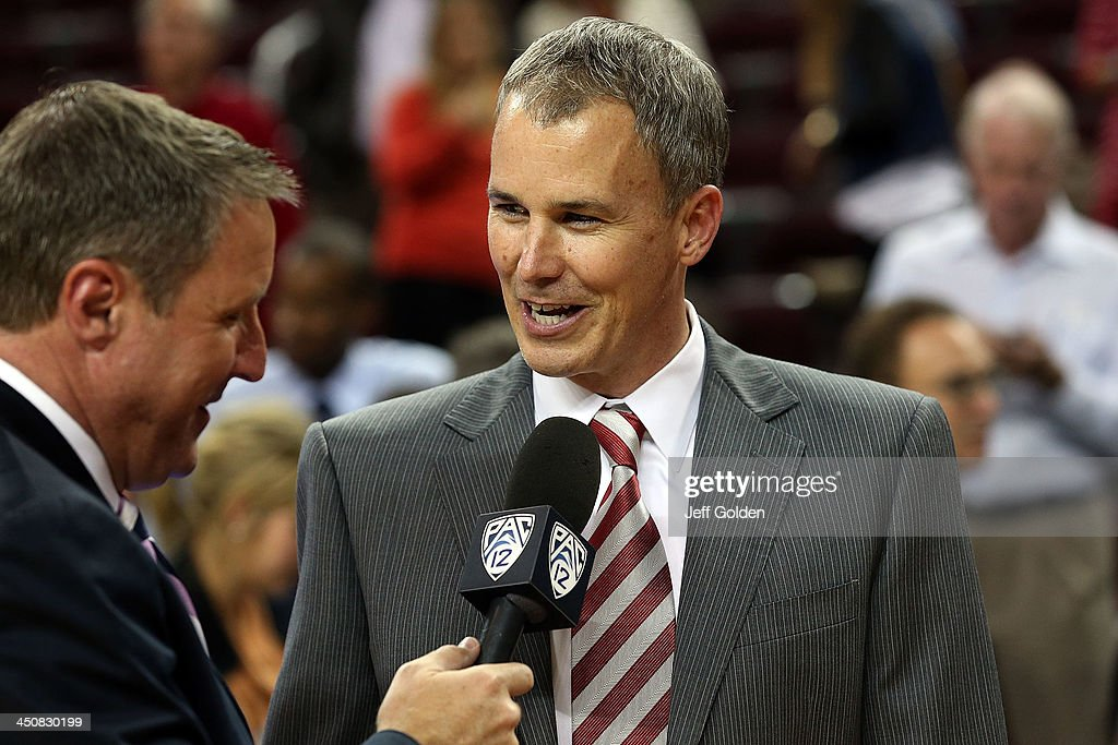 First year head coach <a gi-track='captionPersonalityLinkClicked' href=/galleries/search?phrase=Andy+Enfield&family=editorial&specificpeople=5624033 ng-click='$event.stopPropagation()'>Andy Enfield</a> of the USC Trojans smiles as he is interviewed by Jim Watson on the Pac-12 Network after getting his first win at USC in the home opening game against the Cal State Northridge Matadors at the Galen Center on November 12, 2013 in Los Angeles, California. USC won 95-79.