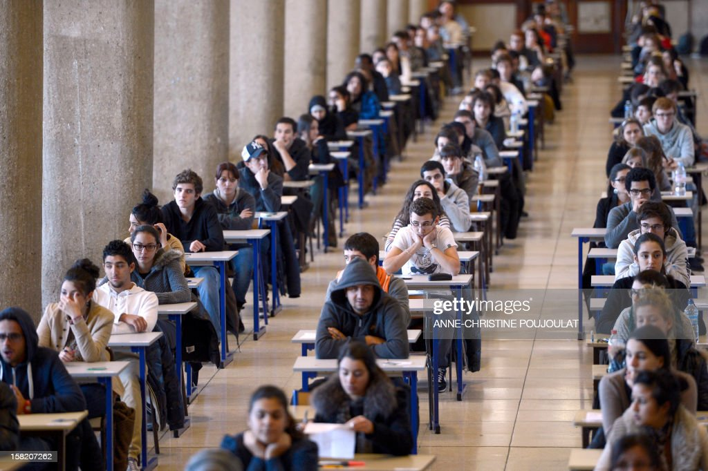 First year medical students get ready to pass their first semester examination on December 11, 2012 at Marseille's medical university of La Timone. AFP PHOTO / ANNE-CHRISTINE POUJOULAT