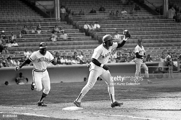 Firstbaseman George Scott of the Boston Red Sox receives the throw to retire outfielder Paul Dade of the Cleveland Indians during the fifth inning of...