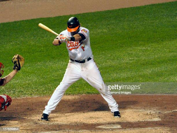 Firstbaseman Mark Reynolds of the Baltimore Orioles gets hit by a pitch from relief pitcher Alfredo Aceves of the Boston Red Sox leading off the...