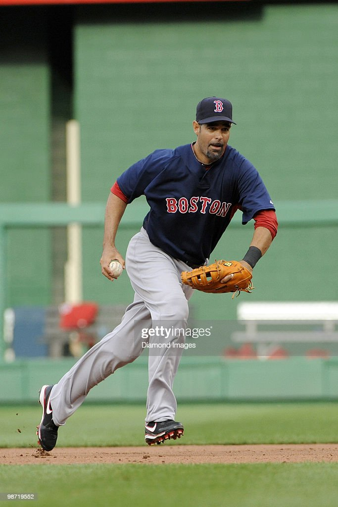 Firstbaseman Mike Lowell of the Boston Red Sox jogs to firstbase after fielding a ground ball to retire Willie Harris of the Washington Nationals...