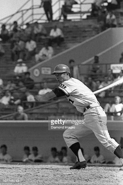 Firstbaseman Sadaharu Oh of the Tokyo Giants of the Japanese Central League watches a ball he's just hit as he turns to run towards firstbase during...