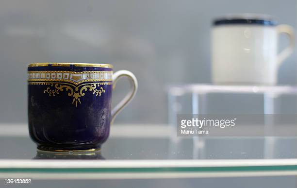 Firstclass passenger china is seen among artifacts recovered from the RMS Titanic wreck site at a press preview of a Titanic artifact auction at the...