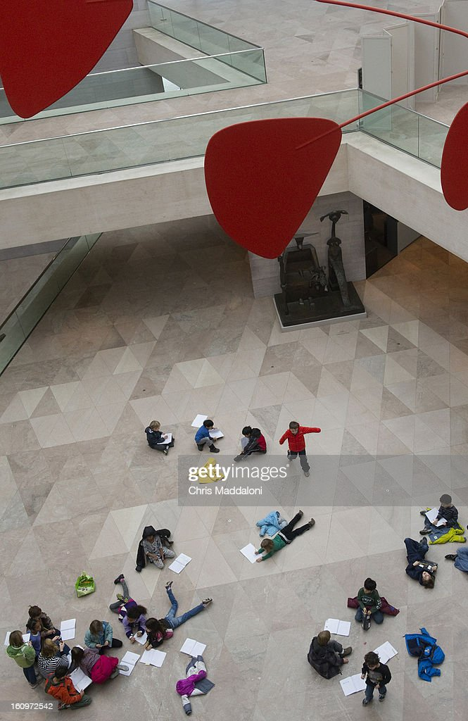 First-grade students from the Capitol Hill Day school study Alexander Calder's mobiles in the National Gallery of Art.