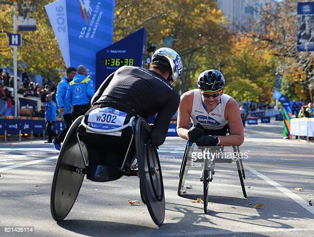 Firstplace finisher Marcel Hug of Switzerland celebrates with secondplace finisher Kurt Fearnley of Australia after the Professional Wheelchair Men's...
